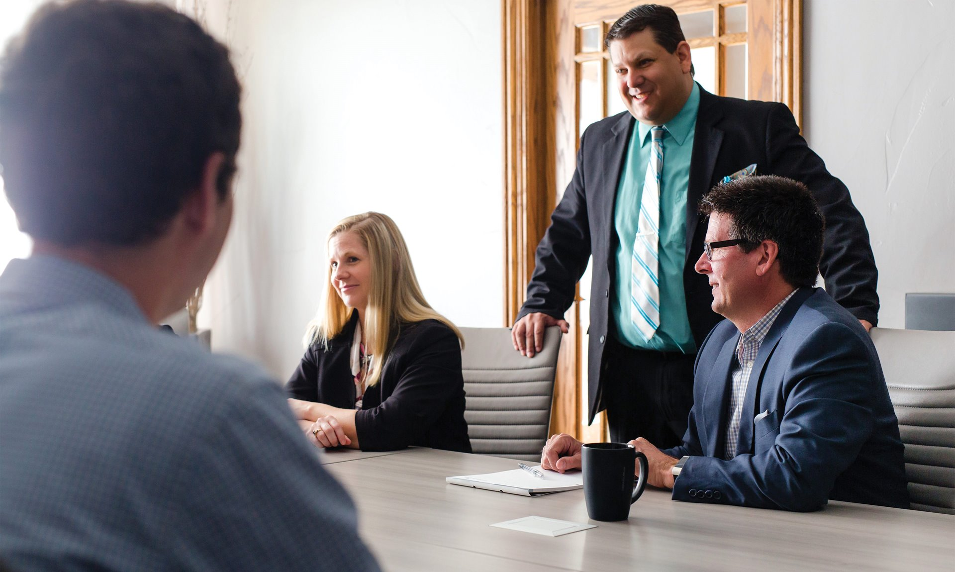 slider image - Attorneys at conference table